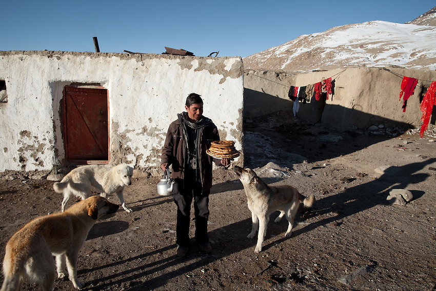 Breakfast brought by the shepherd..The Kyrgyz settlement of Tchelab, near Chaqmaqtin lake, Haji Bootoo Boi's camp...Trekking through the high altitude plateau of the Little Pamir mountains, where the Afghan Kyrgyz community live all year, on the borders of China, Tajikistan and Pakistan.