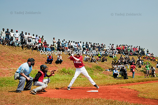 Canadian player Nick Atkinson takes a swing during the game in Mpigi, Uganda on January 17 2012 between Ugandan Little League team and Canadian Little League team from Langley.