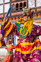 Prakhar Lhakhang, Bumthang, Bhutan.  Buddhist Monk Wearing Mask of a Mythological Deity with Dagger in Hand while Performing a Dance in the Duechoed Religious Festival.