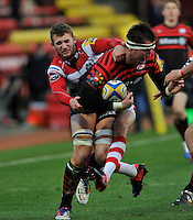 Watford, England. Ernst Joubert of Saracens tackled by  Martyn Thomas of Gloucester Rugby during the Aviva Premiership match between Saracens and at Gloucester Rugby at Vicarage Road on December 2, 2012 in Watford, England.