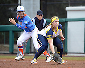Michigan Wolverines infielder Caitlin Blanchard (44) in position as Francesca Martinez (20) leads off first during the season opener against the Florida Gators on February 8, 2014 at the USF Softball Stadium in Tampa, Florida.  Florida defeated Michigan 9-4 in extra innings.  (Copyright Mike Janes Photography)