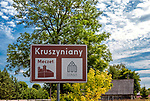 Tablica informacyjna przy wjeździe do Kruszynian, Polska<br /> Information board at the entrance to Kruszyniany, Poland