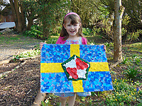 Pictured: Elly Neville with the flag she created circa 2009 <br /> Re: Seven-year-old Elly Neville who was born despite doctors saying her parents would not be able to have any more children, has raised over &pound;150,000 for the cancer ward that treated her father.<br /> Her parents Lyn and Ann had been told they were unlikely to have more children after he underwent a bone marrow transplant in 2005. <br /> Mr Neville subsequently spent a lot of time on the Ward 10 cancer facility at Withybush Hospital in Haverfordwest, Pembrokeshire.<br /> But four years later they were stunned when his painter and decorator wife Ann fell pregnant again.
