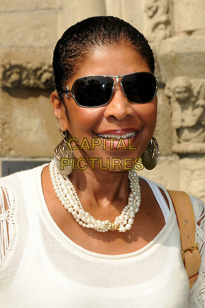NATALIE COLE.Lloyd Klein Couture Fall 2010 Presentation held at Lloyd Klein House of Couture, Los Angeles, California, USA, 24th  March 2010..portrait headshot white necklace earrings sunglasses pearls pearl .CAP/ADM/BP.©Byron Purvis/AdMedia/Capital Pictures.
