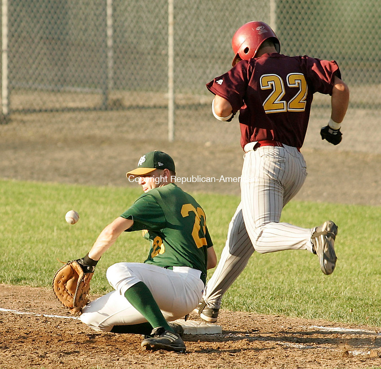 BRISTOL, CT - 07 June 2005 -060705BZ08- Holy Cross #23, Jeffrey Cappa can't control the throw  as Sheehan #22, Tyler Tomer gets safely onto first base<br />  during the class M semifinal at Muzzy Field Tuesday night.<br /> Jamison C. Bazinet Photo