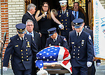 The flag-draped casket containing the remains of Manasquan volunteer firefighter Dan McCann is carried out of St. Cecilia's Church after McCann's funeral mass. McCann died last week after a fire department training exercise.  9/21/16  (Andrew Mills | NJ Advance Media for NJ.com)