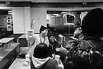 BROOKLYN -- FEBRUARY 14, 2009:  Rapper Aimz (L) shankes some hands of some girls that he meets, while hanging out at McDonald's on Fulton street with his manager Michael Tucker (C), on February 14, 2009 in Brooklyn.  (PHOTOGRAPH BY MICHAEL NAGLE)..