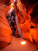 Upper Antelope Canyon near Page Arizona glows from the midday sunlight streaming down through its narrow passageways