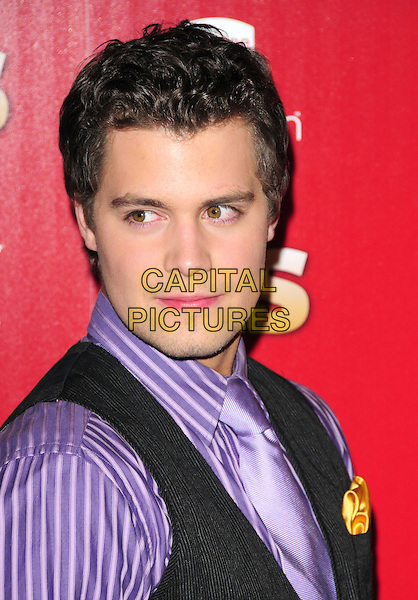 LEVI JOHNSTON.US Weekly's Hot Hollywood Party 2009 held at Voyeur, West Hollywood, California, USA. .November 18th, 2009.headshot portrait black purple striped striped yellow handkerchief.CAP/RKE/DVS.©DVS/RockinExposures/Capital Pictures.
