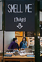 London, UK. 15.11.2014. A sign on the truffle stall invites passing customers to 'smell me'. Borough Market. Photograph © Jane Hobson.