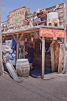 Oatman Arizona is a ghost town unlike most others, originally a mining camp until the lines were shut down by 1941 by the US government as part of the country's war effort. Oatman was saved by route 66 passing right through town, however with the demise of route 66 Oatman became a ghost town and all but faded away. With the renewed interest in route 66 Oatman is once again alive as a tourist destination with stores with the old wooden sidewalks and tin roofs selling art and souvenirs. What makes Oatman unique are the wild burros that roam freely through town looking for handouts and blocking traffic. The most famous building in Town is the Durlin Hotel now known as the Oatman Hotel which was a honeymoon stop for Clark Gable and Carole Lombard and is rumored to be haunted.