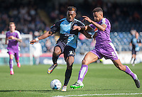 Gozie Ugwu of Wycombe Wanderers  & Curtis Nelson of Plymouth Argyle battle for the ball during the Sky Bet League 2 match between Wycombe Wanderers and Plymouth Argyle at Adams Park, High Wycombe, England on 12 September 2015. Photo by Andy Rowland.