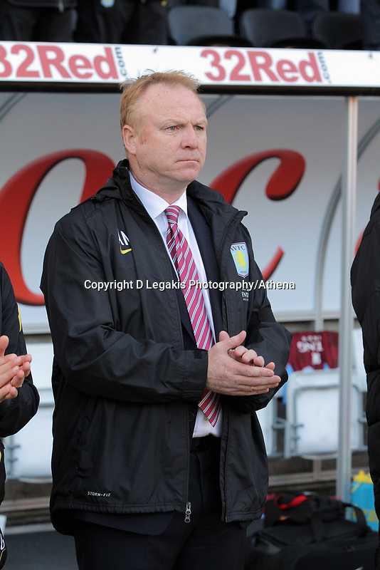 Pictured: Alex McLeish manager for Aston Villa observes a minute's silence  before kick off in memory of Wales football manager Gary Speed who has died. Saturday 27 November 2011<br />