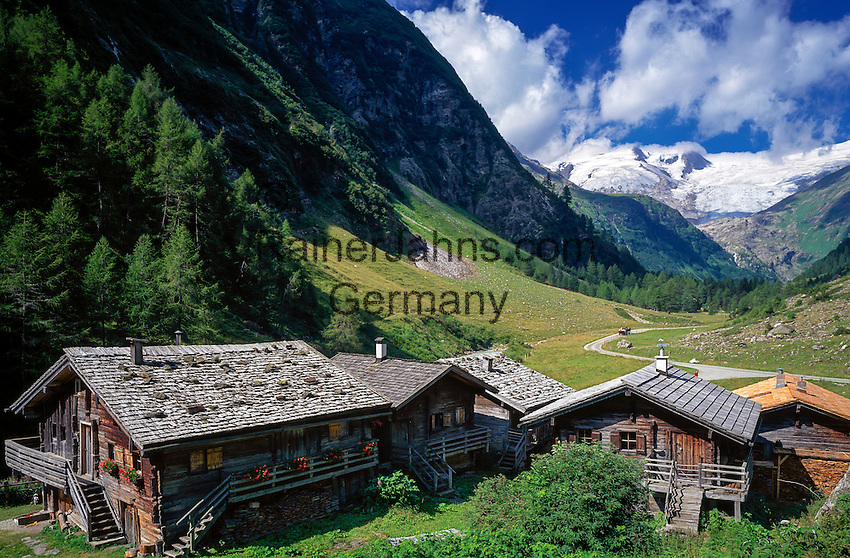 Austria, East-Tyrol, near Matrei, Aussergschloess: alpine pasture huts and Grossvenediger mountain | Oesterreich, Ost-Tirol, bei Matrei, Aussergschloess: Almhuetten vorm Grossvenediger