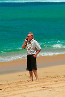 Man in a business meeting on beach with cel phone
