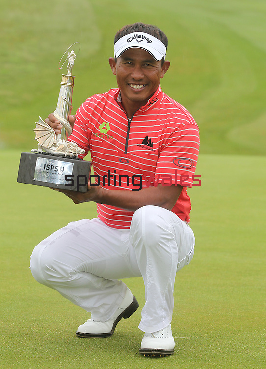 ISPS Handa Wales Open 2012 champion Tongchai Jaidee celebrates with the trophy...03.06.12.©Steve Pope