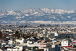 Photo shows the mountains surrounding Aizuwakamatsu City, Fukushima Prefecture, Japan.  Photographer: Rob Gilhooly