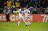 Los Angeles Galaxy's London Donovan and teammate David Beckham slap hands after London kickedin the winning goal against Houston Dynamo to make the score  1-0 in the MLS Cup at the Home Depot Center. Los Angeles Galaxy 1-0 over the Dynamo USA, Sunday, Nov. 20. 20011, in Carson, California. Photo by Matt A. Brown/isiphotos.com