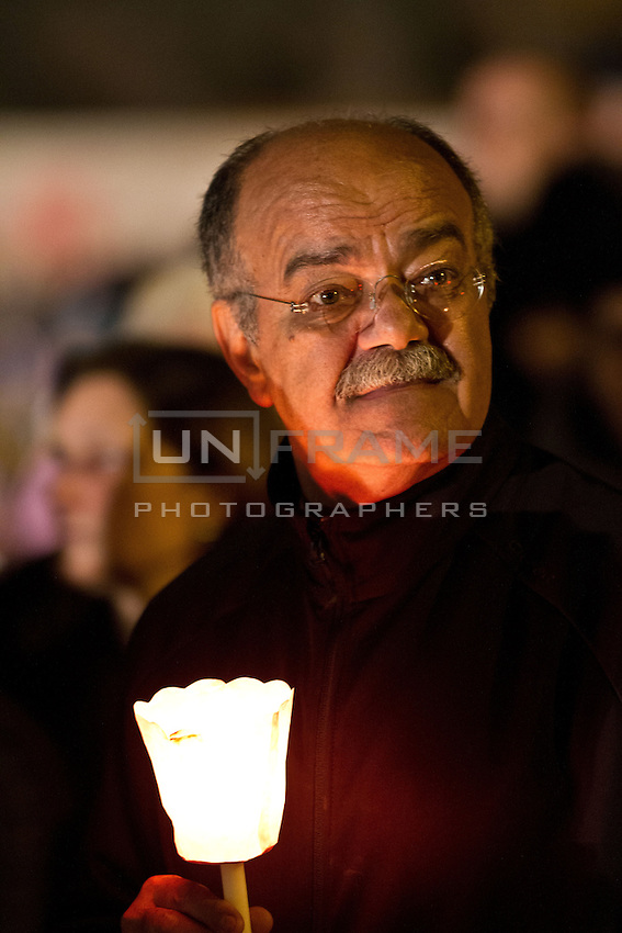 A pilgrim holds a candle during an evening vigil ahead of the beatification of Pope John Paul ll.
