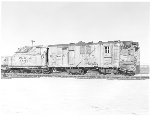 Right side of C&amp;TS rotary snow plow OY at Antonito.<br /> C&amp;TS  Antonito, CO  Taken by Payne, Andy M. - 3/1/1975