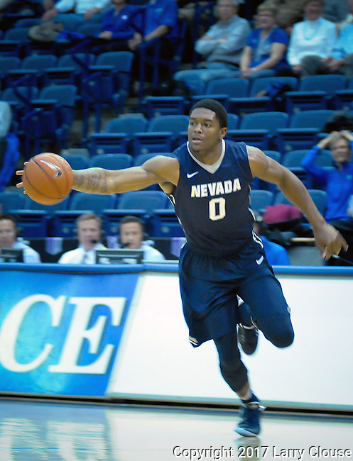 February 15, 2017:  Nevada guard, Cameron Oliver #0, reaches for a loose ball during the NCAA basketball game between the University of Nevada Wolfpack and the Air Force Academy Falcons, Clune Arena, U.S. Air Force Academy, Colorado Springs, Colorado.  Nevada defeats Air Force 78-59.