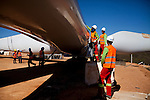 CAETITE, BRAZIL - OCTOBER 25, 2013:<br /> Workers prepare wind blades to be hoisted onto a new tower in a Renova Energia wind-turbine park, in the municipal of Caetite, in Bahia state, Brazil, on Friday, Oct 25, 2013. <br /> (Photo by Lianne Milton/For The Washington Post