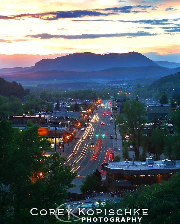 A Summer sunset glows over the Sleeping giant as Lincoln avenue lights up the town.