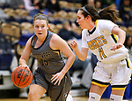 RAPID CITY, SD: DECEMBER 1:  Cooper Courtney #15 of South Dakota Mines dribbles past Racquel Wientjes #11 of Black Hills State during their Rocky Mountain Athletic Conference women's basketball game Saturday evening at the King Center Rapid City, S.D.  (Photo by Richard Carlson/dakotapress.org)