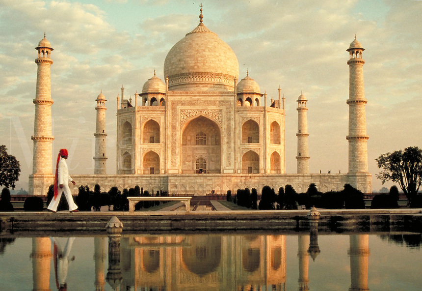 Taj Mahal, Agra, India. Mausoleum built by Shah Jahan for his favorite wife. Man and reflecting pool in foreground.