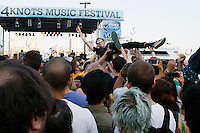 Crowdsurfing at the 4 Knots Festival at South Street Seaport in New York City on July 12, 2014.