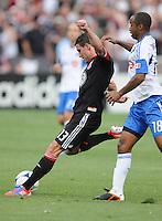 D.C. United forward Chris Pontius (13)  goes against Montreal Impact Collen Warner (18) D.C. United defeated Montreal Impact 3-0 at RFK Stadium, Saturday June 30, 2012.