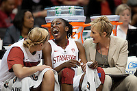 LOS ANGELES, CA - March 11, 2011:  Stanford's Joslyn Tinkle (l) and assistant coach Kate Paye inspect Chiney Ogwumike's chipped tooth during the semi-final game of the 2011 Pac-10 Tournament game against the Arizona Wildcats at Staples Center.  Stanford won, 100-71.