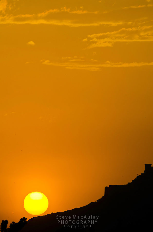 Hari Parbat Fort in silhouette at sunset, Srinagar, Kashmir, India.
