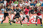 Billy Odhiambo of Kenya tries to tackle Regan Ware of New Zealand, who runs with the ball during the match New Zealand vs Kenya, Day 2 of the HSBC Singapore Rugby Sevens as part of the World Rugby HSBC World Rugby Sevens Series 2016-17 at the National Stadium on 16 April 2017 in Singapore. Photo by Victor Fraile / Power Sport Images