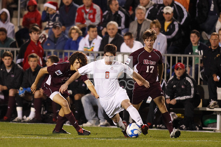 Ohio State Buckeyes midfielder Danny Irizarry (8) is shadowed by a pair of University of Massachusetts Minutemen defenders during an NCAA College Cup semi-final match at SAS Stadium in Cary, NC on December 14, 2007. Ohio State defeated Massachusetts 1-0.