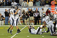 26 December 2010:  FIU kicker Jack Griffin (38) and quarterback Wesley Carroll (13) (tight end Colt Anderson (15) pictured on the ground) celebrate Griffin's game-winning field goal as time expired as the FIU Golden Panthers defeated the University of Toledo Rockets, 34-32, to win the 2010 Little Caesars Pizza Bowl at Ford Field in Detroit, Michigan.