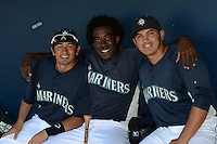 Seattle Mariners shortstop Pedro Okuda (66), outfielder Gabriel Guerrero (10) and catcher Johan Quevedo (52) in the dugout before an Instructional League game on October 4, 2013 at Peoria Stadium in Peoria, Arizona.  (Mike Janes/Four Seam Images)