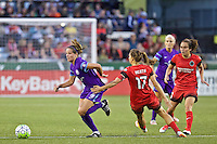 Portland, Oregon - Sunday April 17, 2016: Orlando Pride midfielder/defender Maddy Evans (18)  is defended by Portland Thorns FC midfielder Tobin Heath (17). The Portland Thorns play the Orlando Pride during a regular season NWSL match at Providence Park.