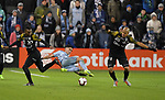Juan Gonzalez (left) and Gustavo Bolivar (right) of Independiente vie for the ball with Felipe Gutierrez of Sporting KC. Sporting KC defeated Club Atletico Independiente 3-0 in a CONCACAF Champions League quarterfinal game at Children's Mercy Park on March 14, 2019.