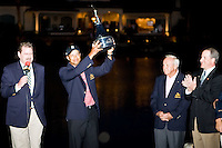 March 29, 2009, Arnold Palmer Invitation.   Tiger Woods displays the winning trophy while tournament host Arnold Palmer looks on. Woods won the tournament with a birdie putt on the 18th hole to break a tie with Sean O'Hair...