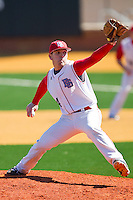 Relief pitcher Tommy Dill #14 of the Delaware State Hornets in action against the Georgetown Hoyas at Gene Hooks Field on February 26, 2011 in Winston-Salem, North Carolina.  Photo by Brian Westerholt / Four Seam Images