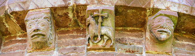 Norman Romanesque exterior corbel sculptures from the Norman Romanesque Church of St Mary and St David, Kilpeck Herefordshire, England. Built around 1140