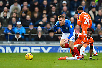 Tom Naylor of Portsmouth gets away from Armand Gnanduillet of Blackpool during Portsmouth vs Blackpool, Sky Bet EFL League 1 Football at Fratton Park on 12th January 2019
