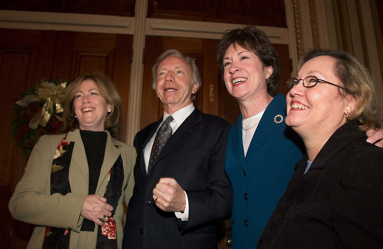 12/08/04.INTELLIGENCE REFORM/SENATE VOTE----Sept. 11 Commission family steering committee members Mary Fetchet, far left, and Carol Ashley, far right, with Senate Governmental Affairs ranking Democrat Joseph I. Lieberman, D-Conn., and Chairman Susan Collins, R-Maine, celebrate during the vote in the Senate on the intelligence overhaul conference report, which cleared 89-2..CONGRESSIONAL QUARTERLY PHOTO BY SCOTT J. FERRELL