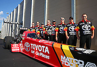 Sep 13, 2013; Charlotte, NC, USA; NHRA top fuel dragster driver Antron Brown and his crew pose for a portrait prior to qualifying for the Carolina Nationals at zMax Dragway. Mandatory Credit: Mark J. Rebilas-