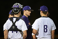 Northwestern Wildcats coach Josh Reynolds talks with pitcher Dan Kubiuk (8) and catcher Jack Claeys (44) during a game against the Saint Leo Lions on March 4, 2016 at North Charlotte Regional Park in Port Charlotte, Florida.  Saint Leo defeated Northwestern 5-3.  (Mike Janes/Four Seam Images)