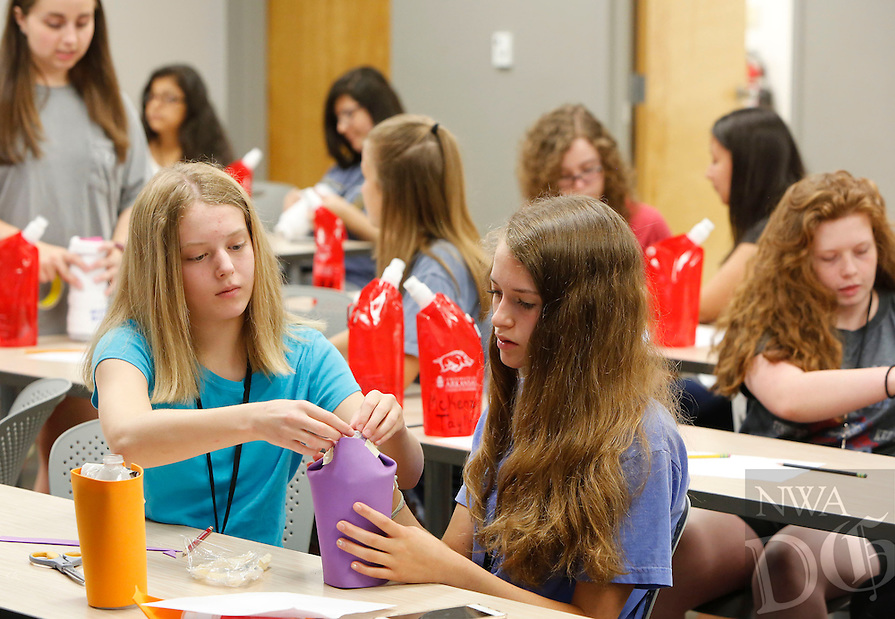 NWA Democrat-Gazette/DAVID GOTTSCHALK  Bailey Johnson (left) 14, and anna Sherwood, 14, work on their water bottle insulation project Tuesday, July 19, 2016, as they participate in a chemical engineering experiment at Engineering Girl Camp at the University of Arkansas in Fayetteville. The weeklong half day camp open to eighth and ninth grade girls is  one of four Engineering Summer Camp 2016 offered at the University.