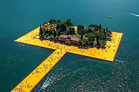 Sulzano, Iseo Lake, ITALY - JUNE 28, 2016: Aerial view installation view of 'The Floating Piers' made by artist Christo Vladimirov Yavachev and Jeanne-Claude Denat de Guillebon. The Istallation connects the village of Sulzano to the small island of Monte Isola and another very small island (Isola di San Paolo).