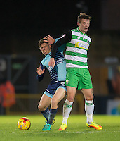 Dominic Gape of Wycombe Wanderers & Matt Butcher of Yeovil Town during the Sky Bet League 2 match between Wycombe Wanderers and Yeovil Town at Adams Park, High Wycombe, England on 14 January 2017. Photo by Andy Rowland / PRiME Media Images.