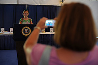 A woman snaps a picture of her daughter at the presidential podium at an exhibit on the American presidential experience at Invesco Field in Denver, Colorado on August 22, 208.  The Democratic National Convention officially kicks off Monday August 25, 2008 at the nearby Pepsi Center.